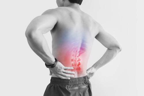 Man with lower back pain, concept of back injury treatment in Birmingham